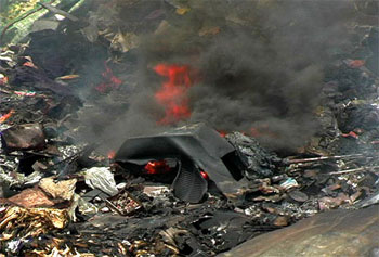 Televisions burning at e-dump in Nigeria